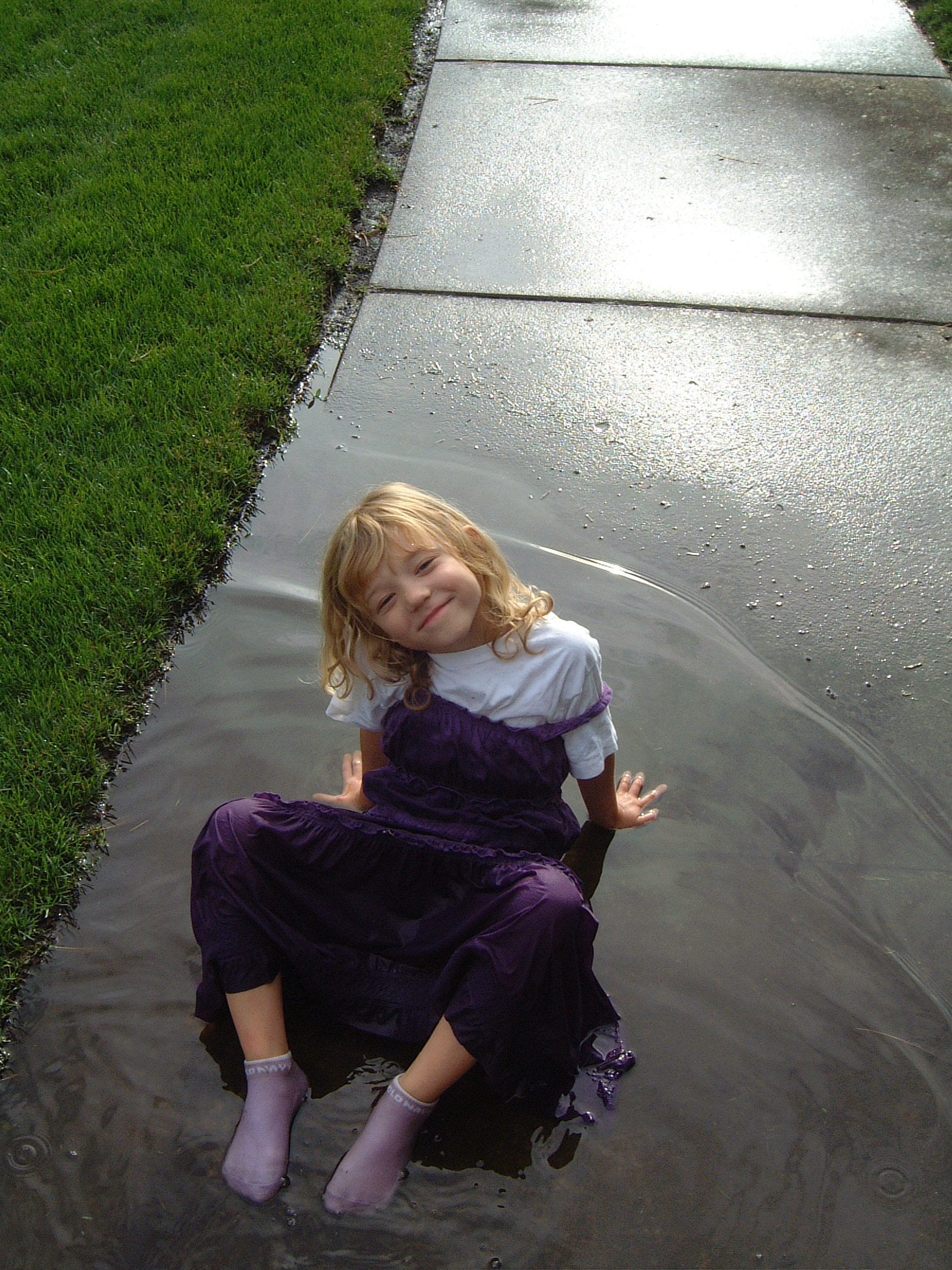 Fall of 2007.  Elisa playing in a mud puddle in her church clothes.